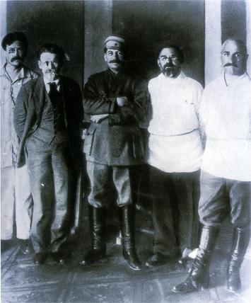 Grigorii Petrovsky standing next to Josef Stalin